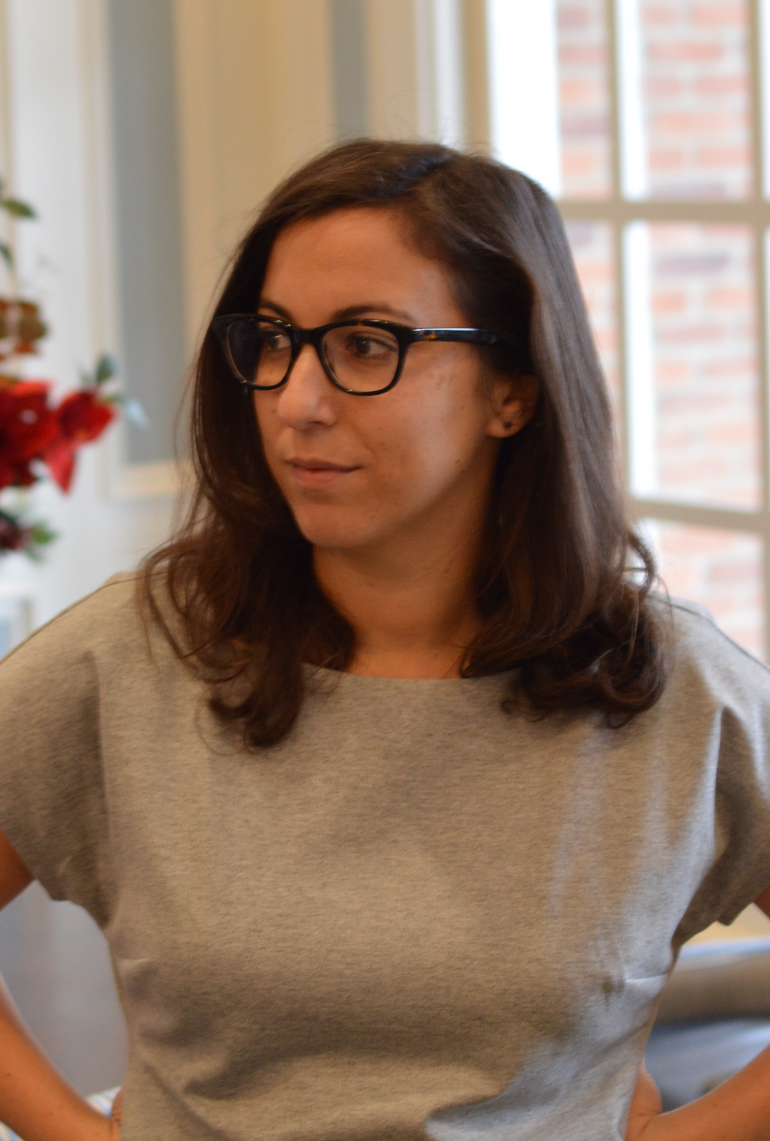An indoor photo of Nicole Bradick  wearing glasses